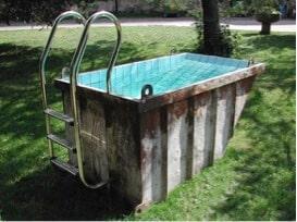 Swimming pool made using a skip bin